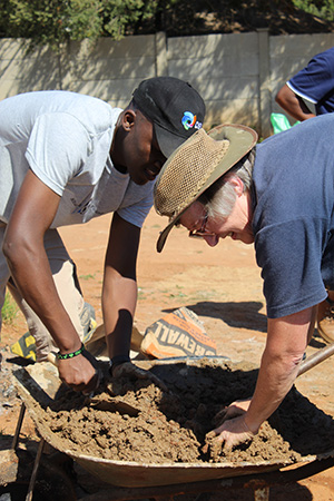 Sipho & Alison mixing soil